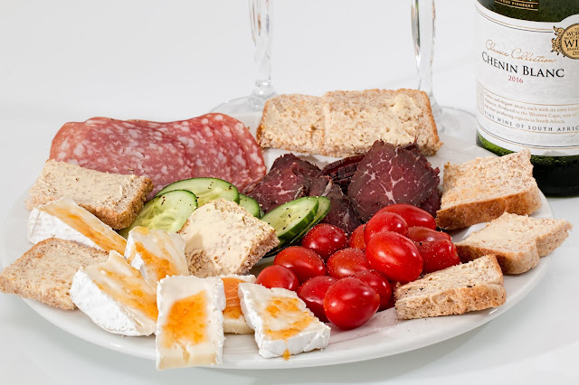 Tomatoes cucumbers bread and cheese platter
