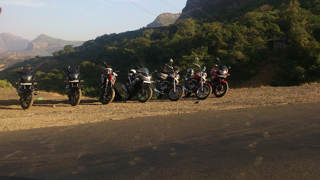 bikes parked at the end of a ghat section in a line afront beautiful nature