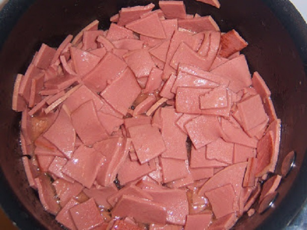 this is fried bologna in a frying pan
