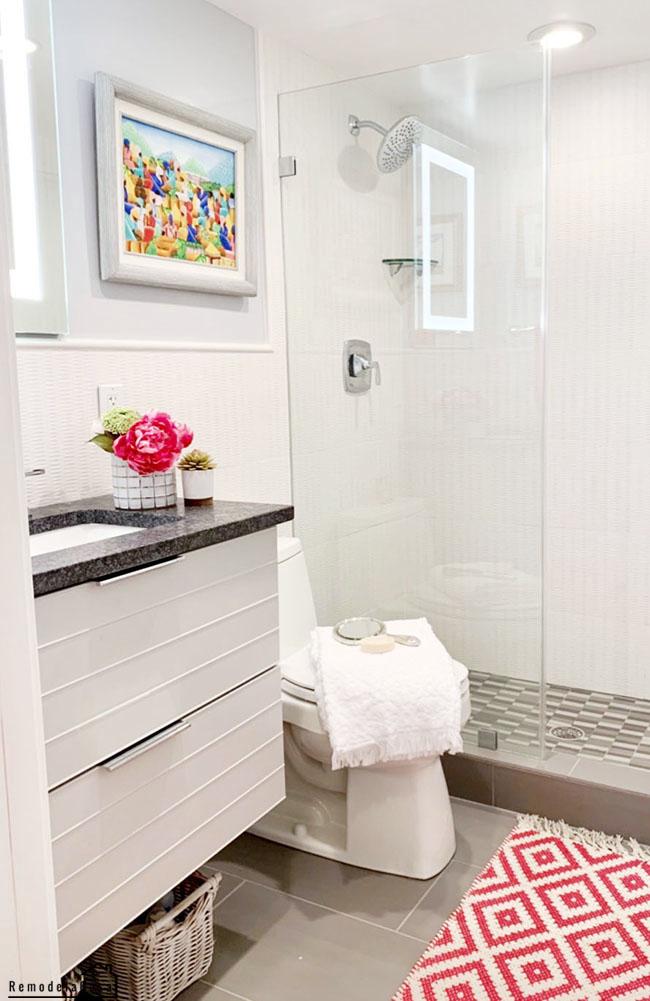 white, gray bathroom with fuchsia accents.