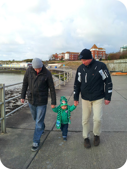 three generations, father and son, grandfather and son, seaside walk