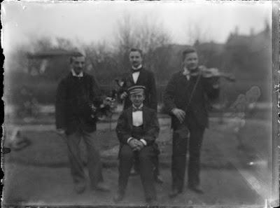 Foto von vier Musikanten - um 1900
