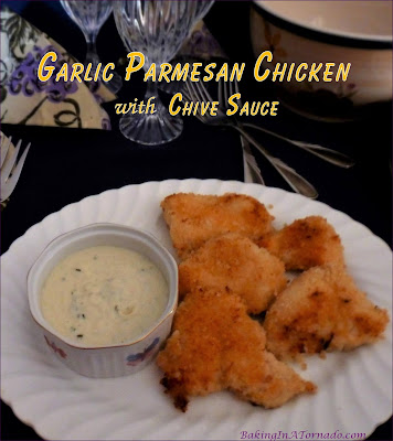 Garlic Parmesan Chicken with Chive Sauce are marinated, crusted chicken breast pieces baked and served with a creamy chive sauce. | Recipe developed by www.BakingInATornado.com | #recipe #dinner