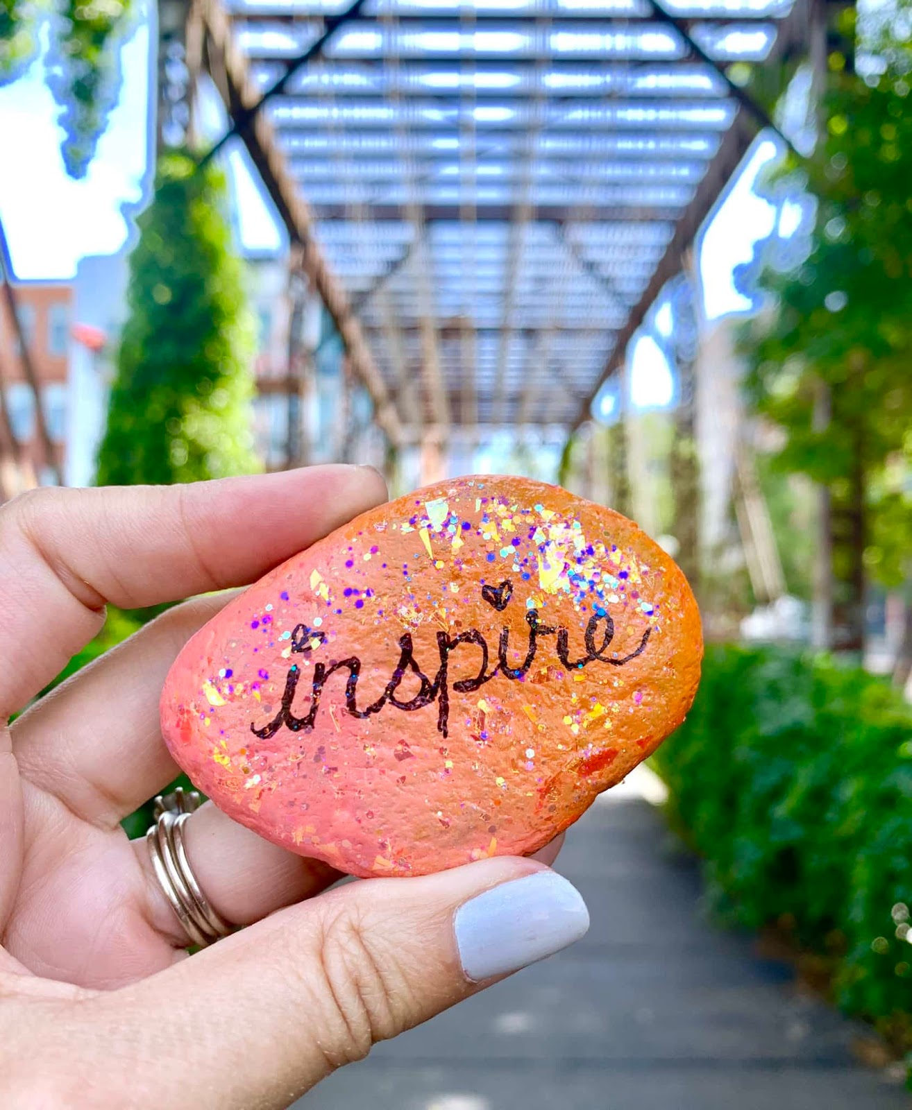 inspire painted stone with glitterific paint
