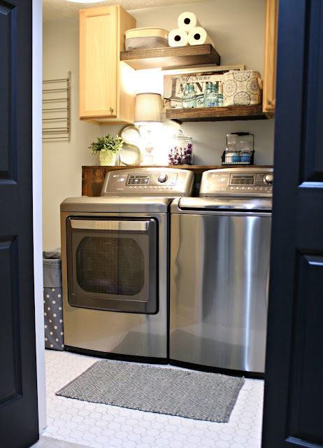 Basement laundry room with shelves for storage