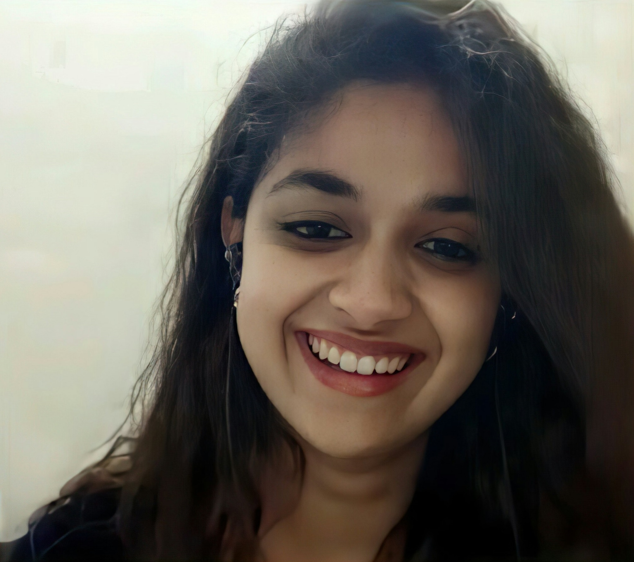 Keerthy Suresh with Chubby Cheeks Smile while in Video Live Chat