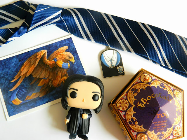 Flatlay of Harry Potter Ravenclaw Merch and a Pop figure of Snape