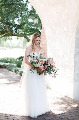 bride with her bouquet at casa feliz