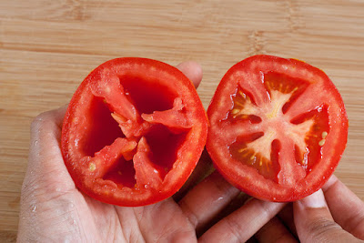 Halved tomato with seeds and without