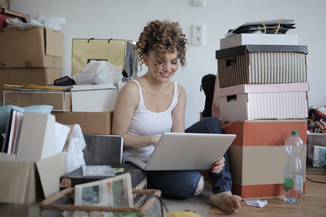 Decluttering for a move- women making decluttering strategies