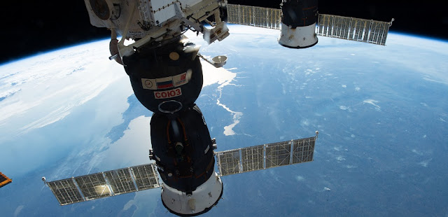 Two Russian spacecraft, the Soyuz MS-09 crew ship (foreground) and the Progress 70 resupply ship, are pictured docked to the International Space Station as the orbital complex orbited nearly 257 miles above Ukraine. Credit: NASA