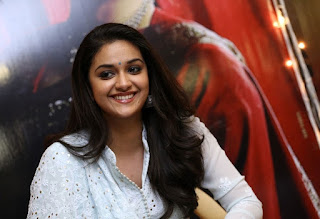 Keerthy Suresh in White Dress with Cute and Awesome Lovely Smile at Mahanati Promotions 11