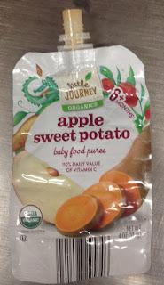 An empty pouch of Little Journey Organics Apple Sweet Potato Baby Food Puree, from Aldi