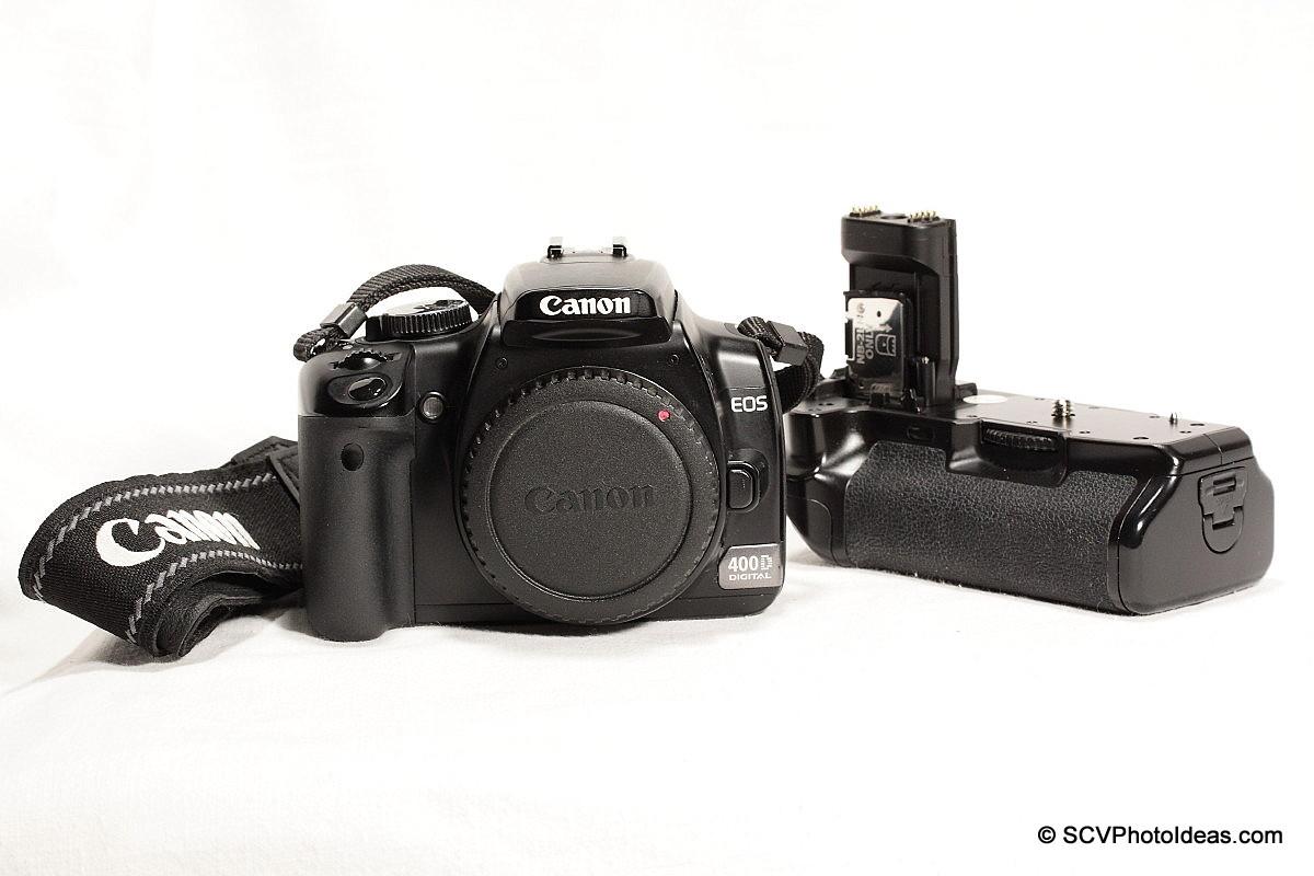 Canon EOS 400D w/ BG-E3 aside