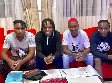 Naira Marley signs four new acts to his record label