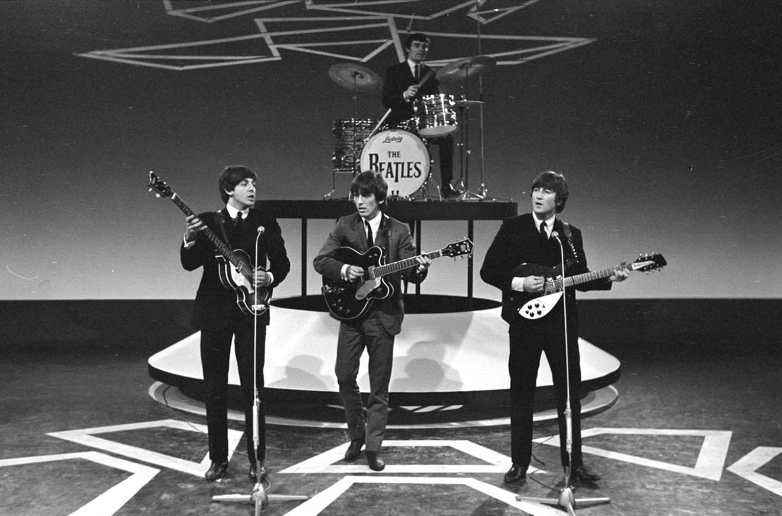 The Beatles during television recordings in Hillegom, Netherlands, on June 5, 1964. Drummer Ringo Starr was briefly hospitalized after a tonsillectomy, and Jimmie Nicol sat in on drums for several concerts.