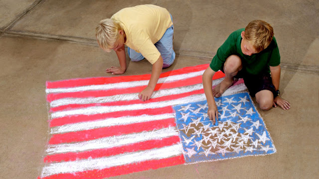 Children drawing the United States Flag with Chalk