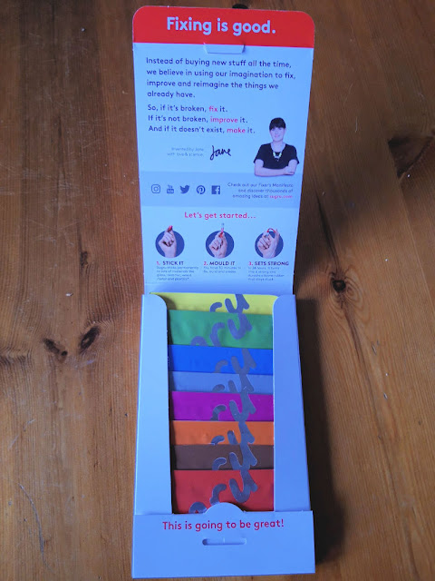Image shows the contents of the packet.  There are 8 coloured packets of Sugru glue inside the box.