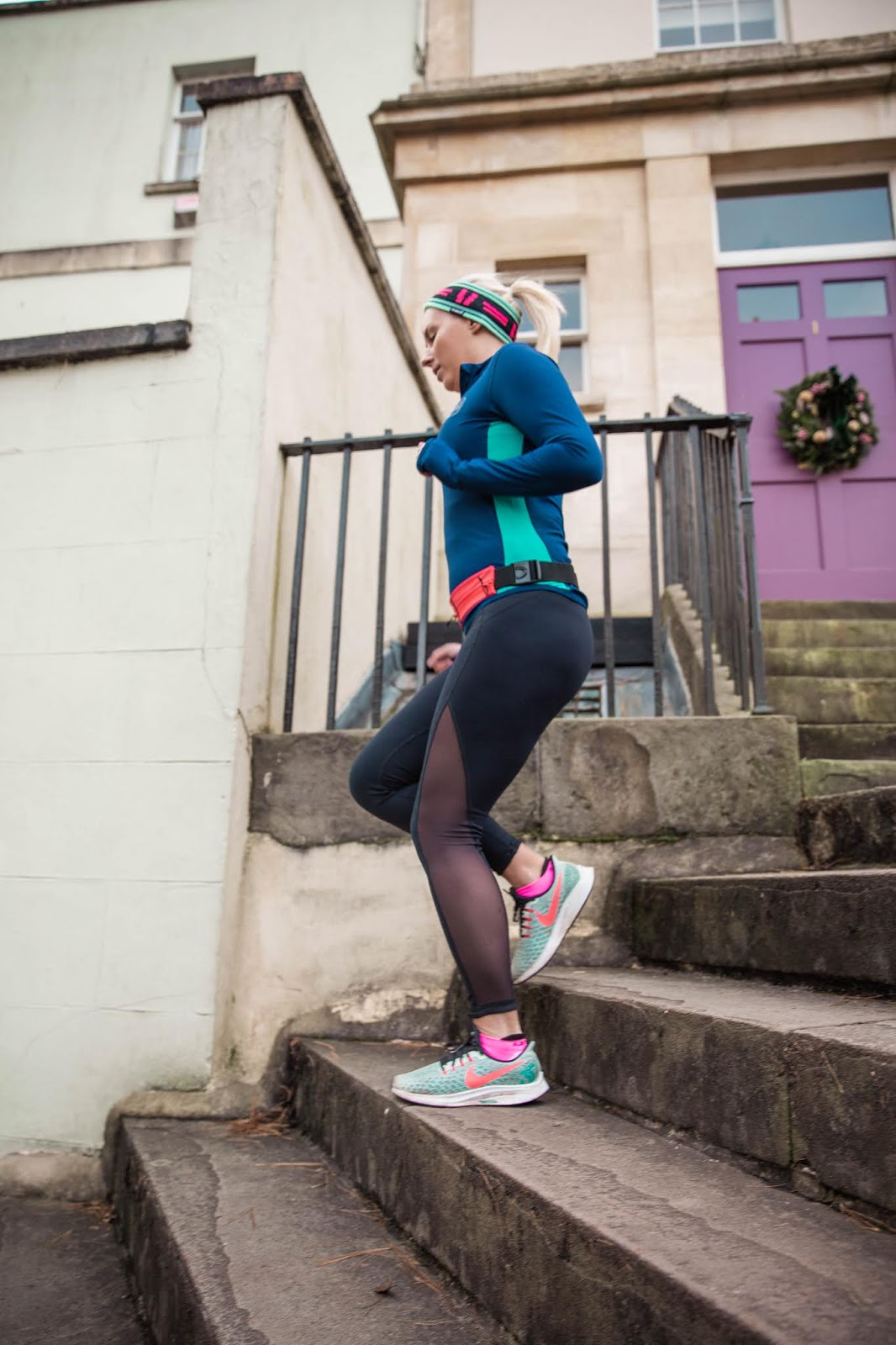 Rachel Emily Running Down some steps in black, pink and blue running gear - Rachel Emily Blog