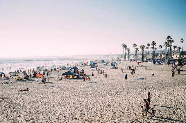 people enjoying the beach at Newport Beach California