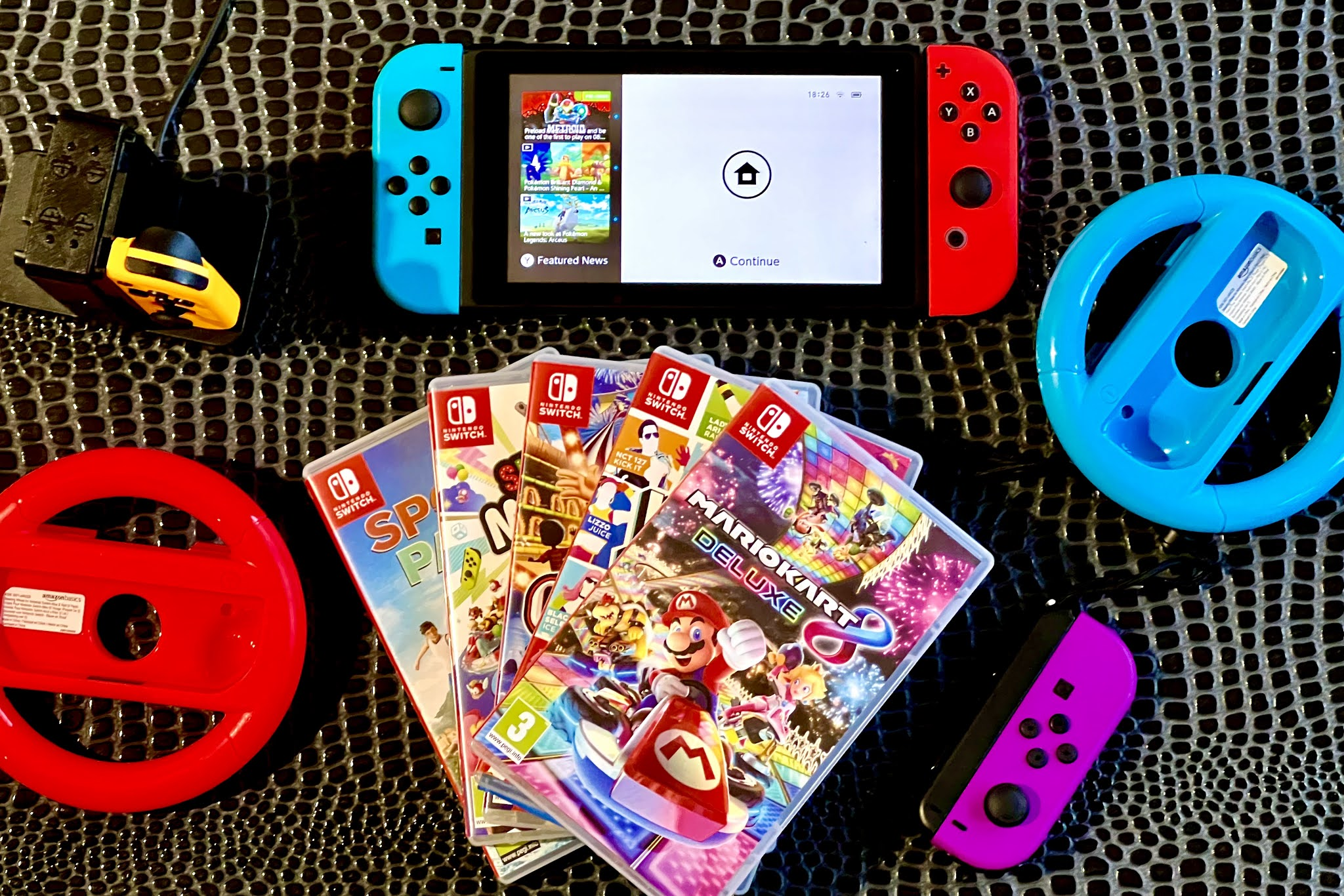 The games and accessories we recommend when buying a Nintendo Switch for family including extra joy-con and a charging unit