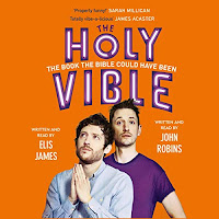 Elis and John Present the Holy Vible audiobook cover. Elis James (left) stands with hands clasped in prayer, wearing a blue shirt. John Robins (right) in purple, looks into the camera. The background is orange with the title above the men.