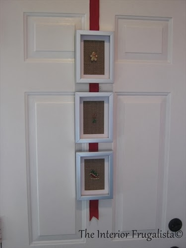Attached framed Christmas brooches to a red ribbon