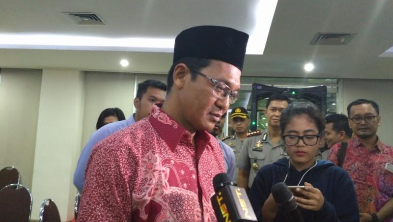 KH Ahmad Ishomuddin memberi keterangan usai sidang
