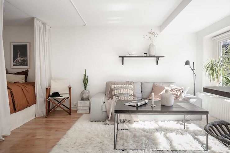 Salón con dormitorio incorporado.