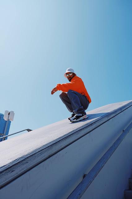 Man wearing white bucket hat: Photo by Mike Von on Unsplash