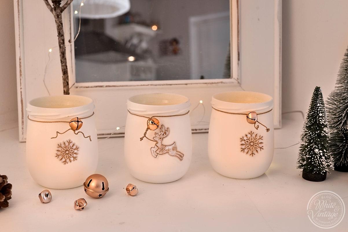 Weihnachtliche Windlichter aus Altglas basteln.