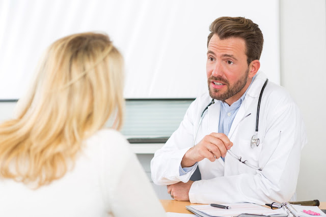 Female patient talks with her doctor about her concerns
