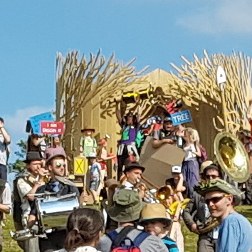 Cardboardia Parade top of big hill close up of my partner with jackhammer