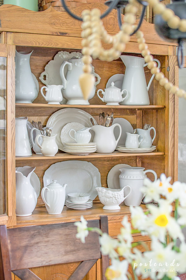 antique oak hutch with vintage white ironstone platters and pitchers