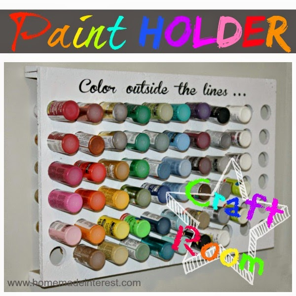 A paint holder that is all organized hanging on the wall.