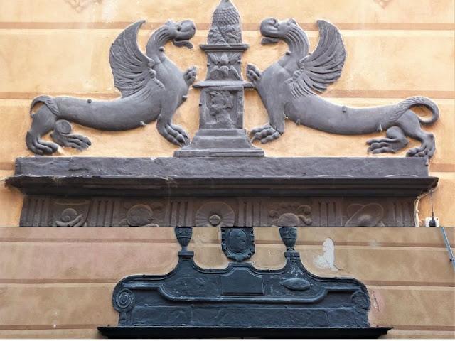 elementi decorativi sopra negozi del centro storico