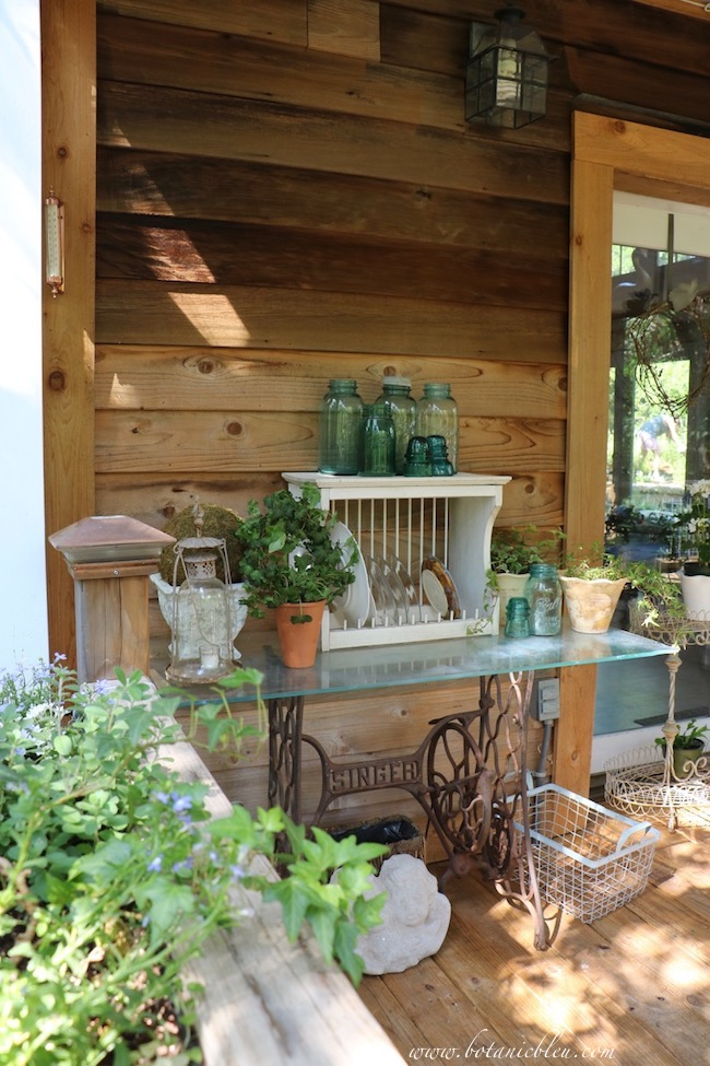 A small outdoor table serves as a storage table for collections