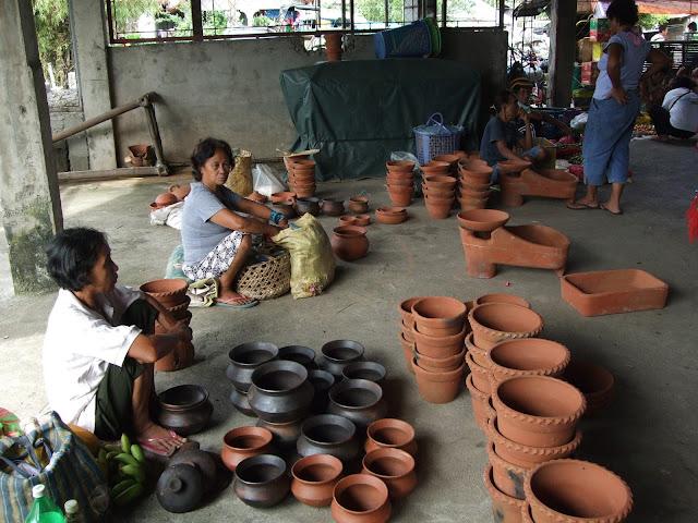 women selling clay pots in the market