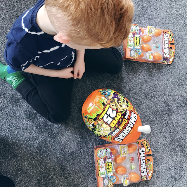 Overhead shot of a little boy looking at the egg toys