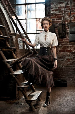 An example of a waist cincher or waspie used in women's steampunk fashion. This woman wears her waist cincher with a blouse, skirt and boots.