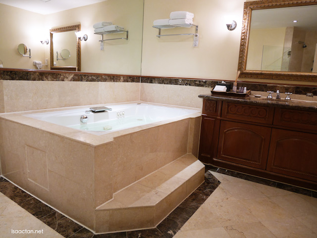 Huge bathroom, with attached bathtub with jacuzzi