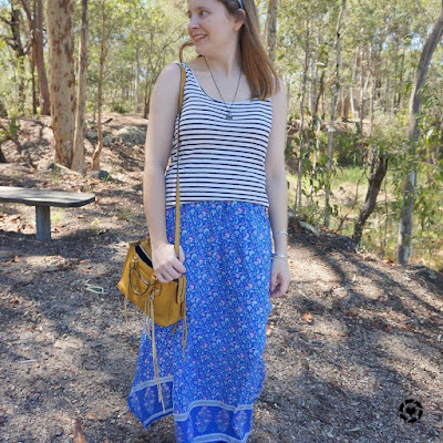 awayfromtheblue Instagram | striped tank with floral maxi skirt and mustard bag for spring print mix