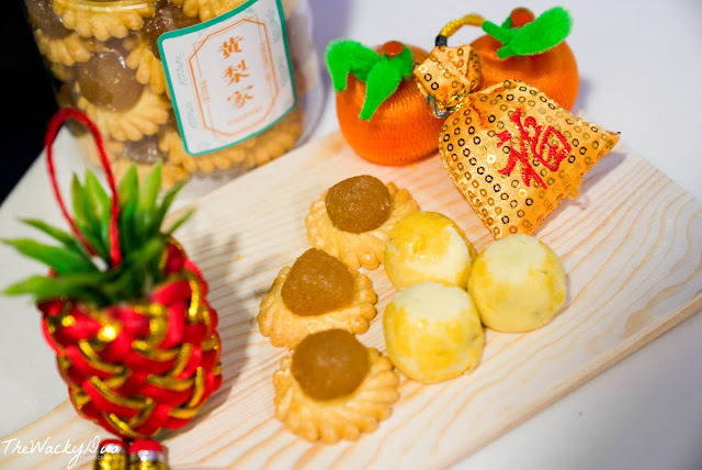 Pineapple Tarts on a wooden plate