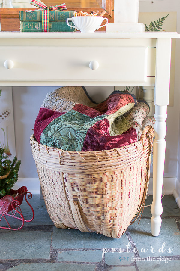 vintage quilt with velvet fabric pieces in large basket