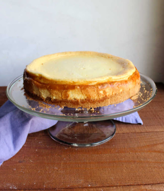 whole cheesecake on cake stand