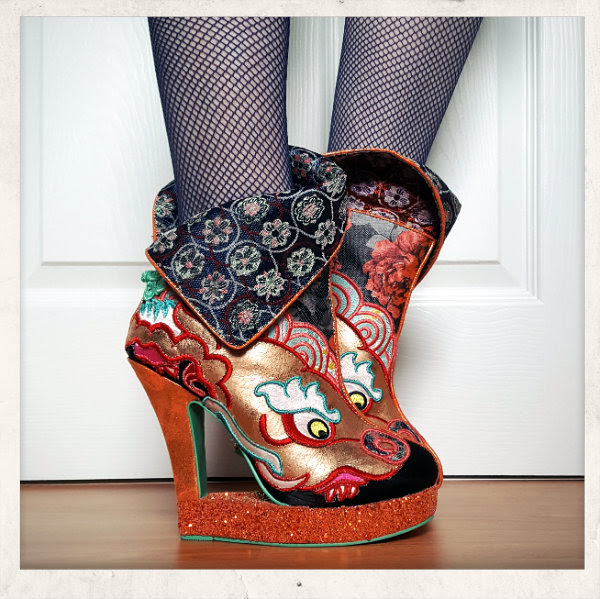 side view of Irregular Choice Tatsu ankle boots with cut out heel and cuff worn half up half down