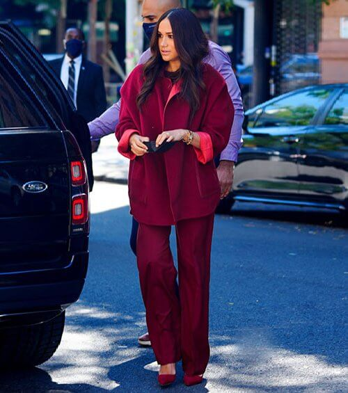 Meghan Markle wore an outfit from Loro Piana's Fall Winter 2021 Collection. Loro Piana Loreen cashmere cape and Antoine virgin pants