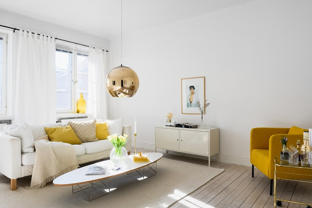 Accente galben muștar în amenajarea unui apartament de 55 m²