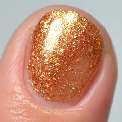 rum gold flakie nail polish close up swatch