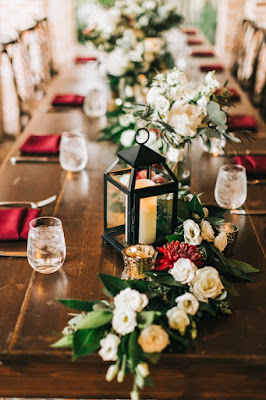 table setting and red and green foliage decor